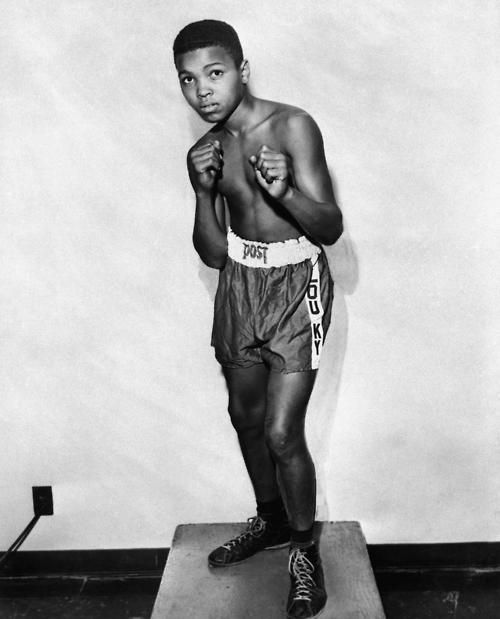 A 12-year old Muhammad Ali, then Cassius Clay, strikes a pose in 1954.