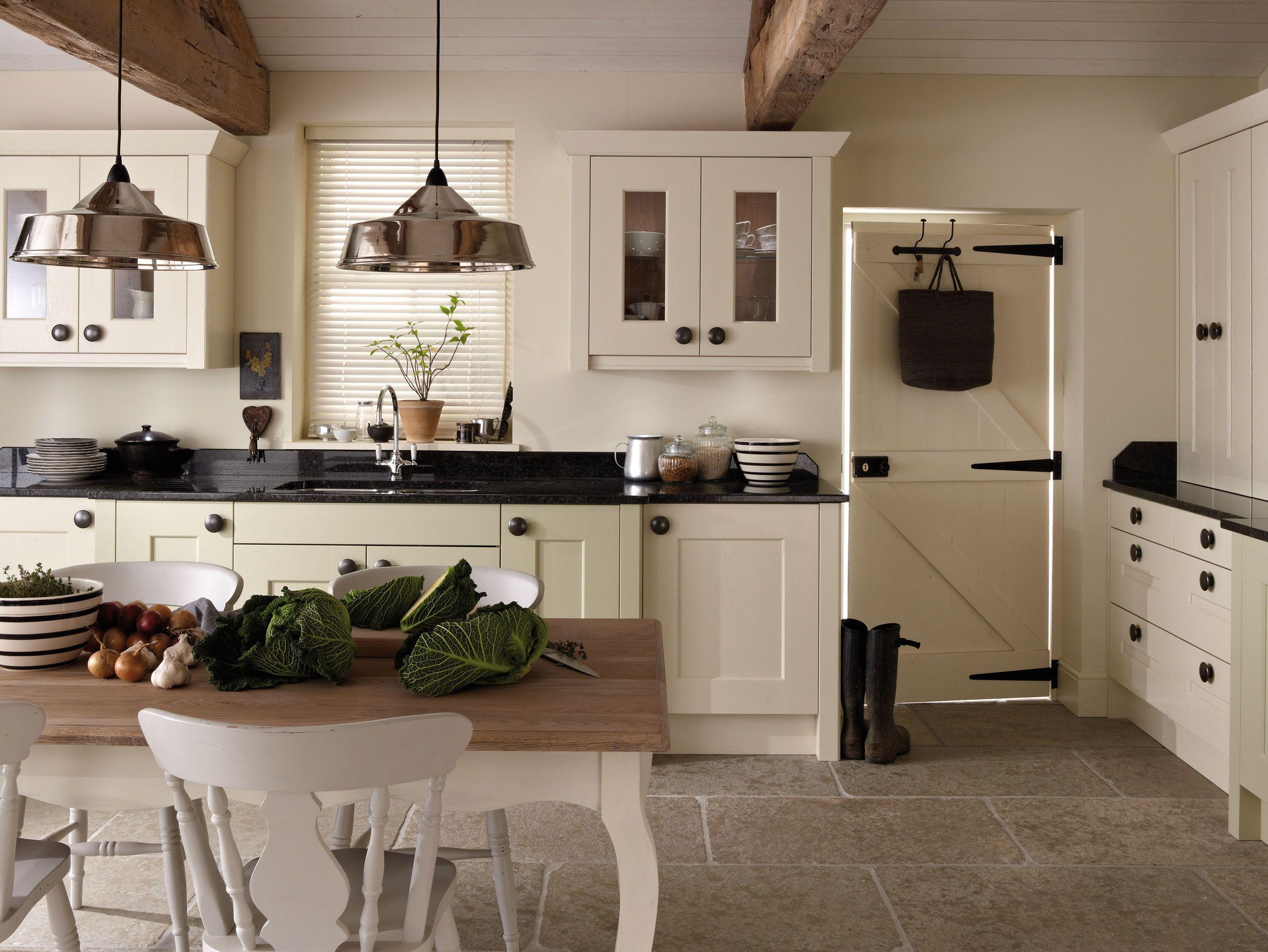 Vivacious White Cream Kitchen Cabinet And Black Marble Countertop