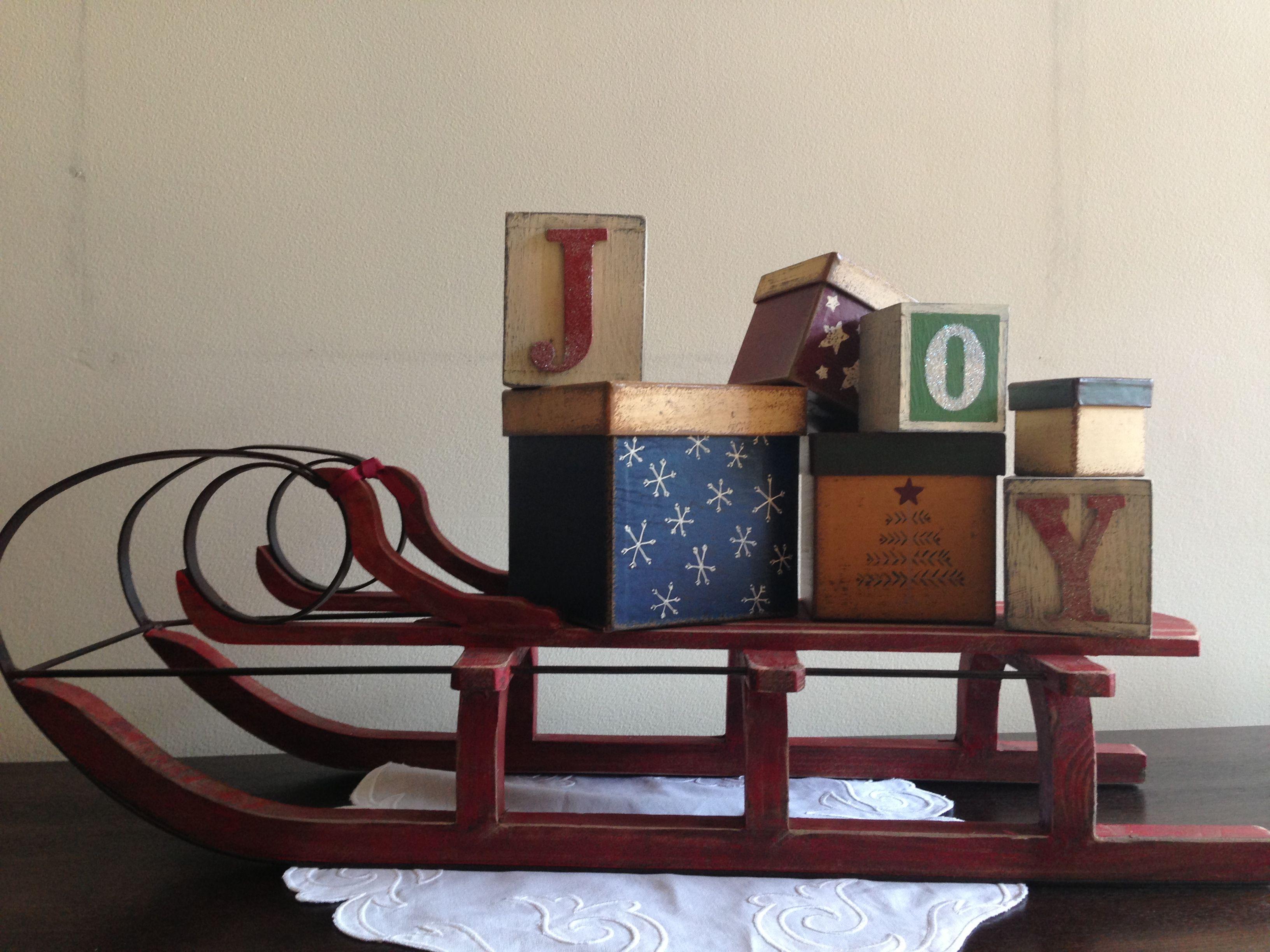 Joy in a little wooden sleigh.