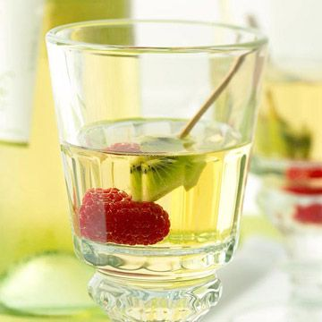 White Wine Spritzer: 1 bottle sweet white wine, 3/4 cup white grape juice or apple juice, 1 liter low cal chilled sparkling water, and assorted fresh fruits (raspberries, sliced kiwifruit, blueberries, lemon slices, lime slices, halved strawberries, and/or red grapes) Servings Per Recipe: 10 PER SERVING: 80 cal., 14 mg sodium, 6 g carb.