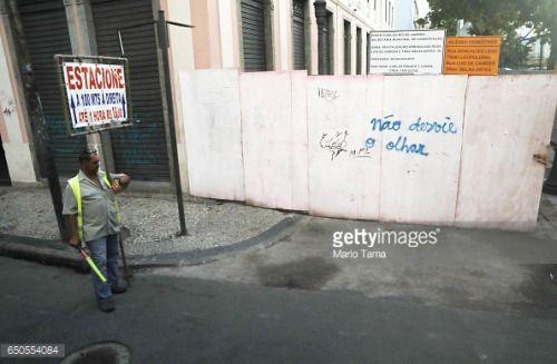 03-10 RIO DE JANEIRO, BRAZIL - MARCH 08: A worker holds... #banosdemontemayor: 03-10 RIO DE JANEIRO, BRAZIL - MARCH 08:… #banosdemontemayor