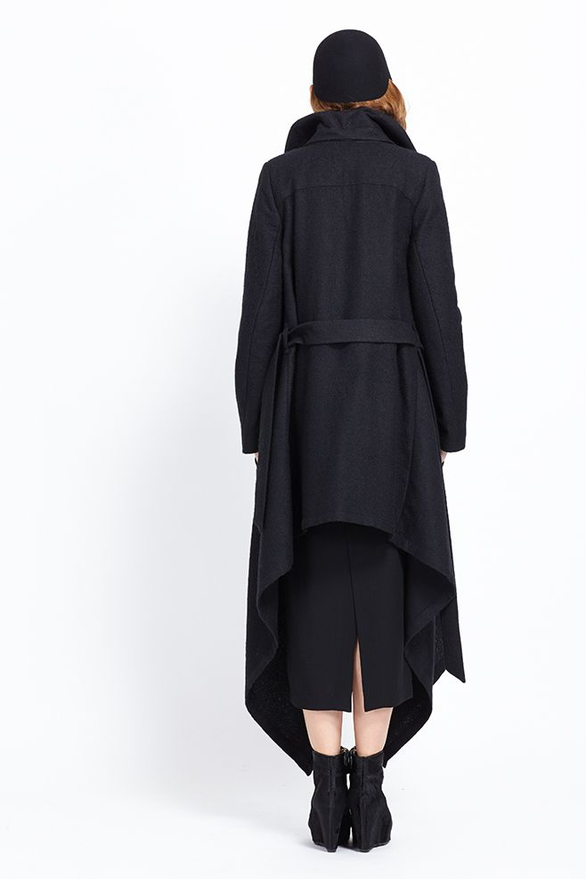 Longsleeve heavyweight textured coat with oversized high collar. Dramatic draping at collar and bottom. Bottom hem longer at sides than at back and front. Asymmetric button details at collar allow coat to be buttoned several different ways. Front pockets at sides. Tie belt around waist.