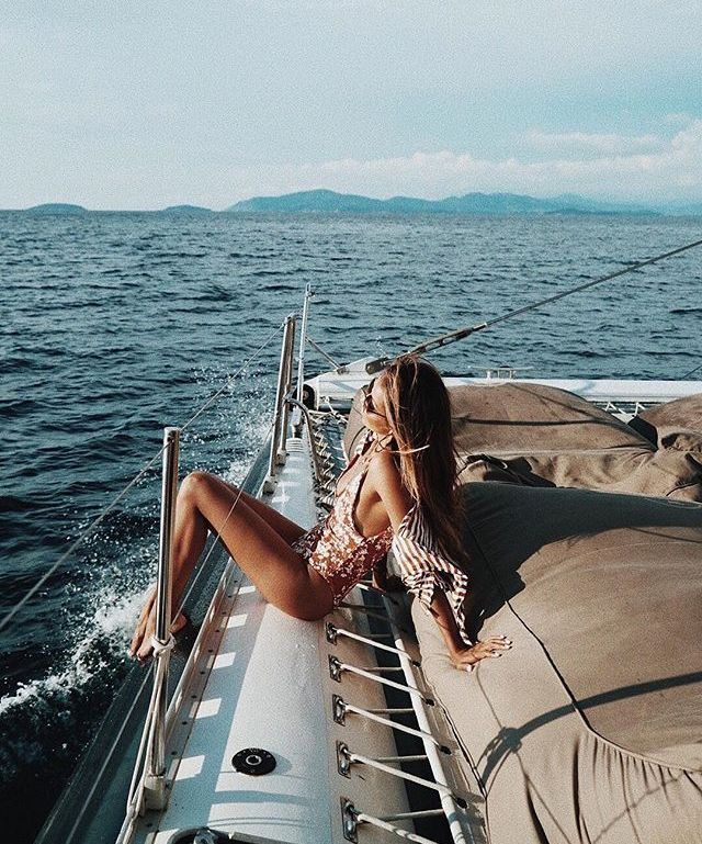 Sexy Woman Standing Near Wooden Boat Stock Photo