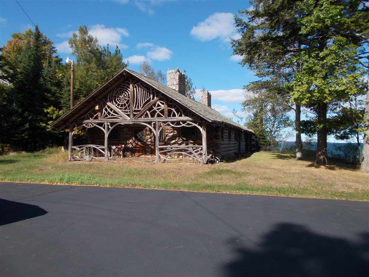 porch cabins portfolio michigan of vacation all rentals northern our in homes escapes browse