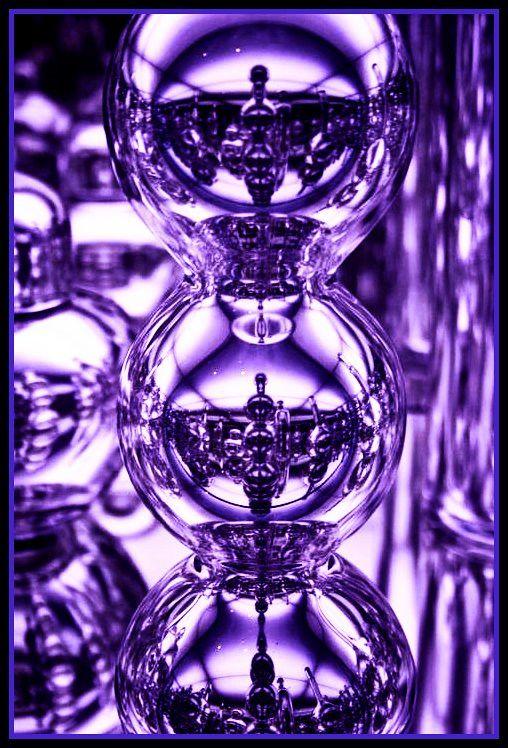 Bottles Reflected In Purple