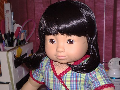 Today I went to the store and purchased the new Asian bitty twin girl. SHE IS AWESOME!  Her face is the sweetest. Closed mouth, button nose etc. She's got smooth shoulder length dark brown/black hair