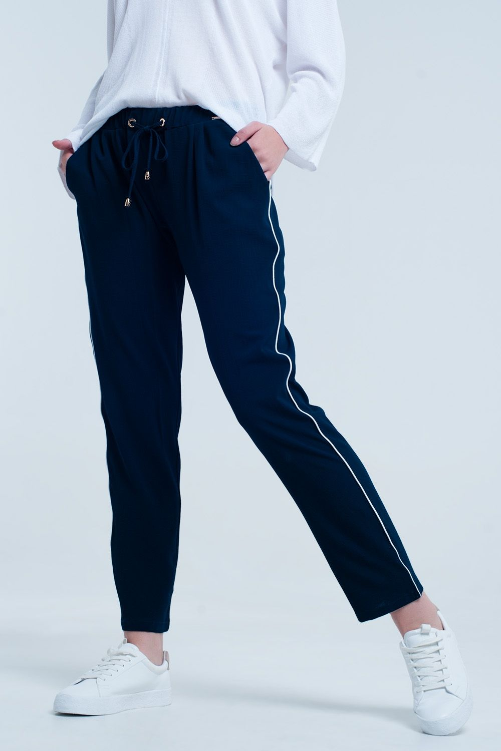 6c9aeb6ff25ef Navy blue pants with lateral white lines on each side. Comfortable  material. Perfect for formal wear during any season.