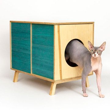 A Modern way to hide the litter box! Loving the sphinx cat in the product photos, too.