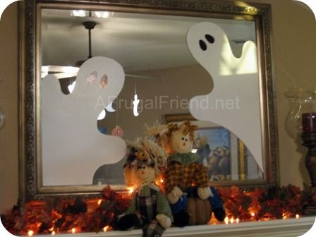 Easy to make these Mirror #Ghosts with white poster board. #DIY #Halloween Home Decor