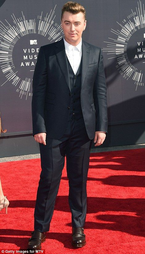 Gentlemen all the way: Usher wore a unique get-up and signature shades while Stay With Me Sam Smith rocked a white shirt and black suit