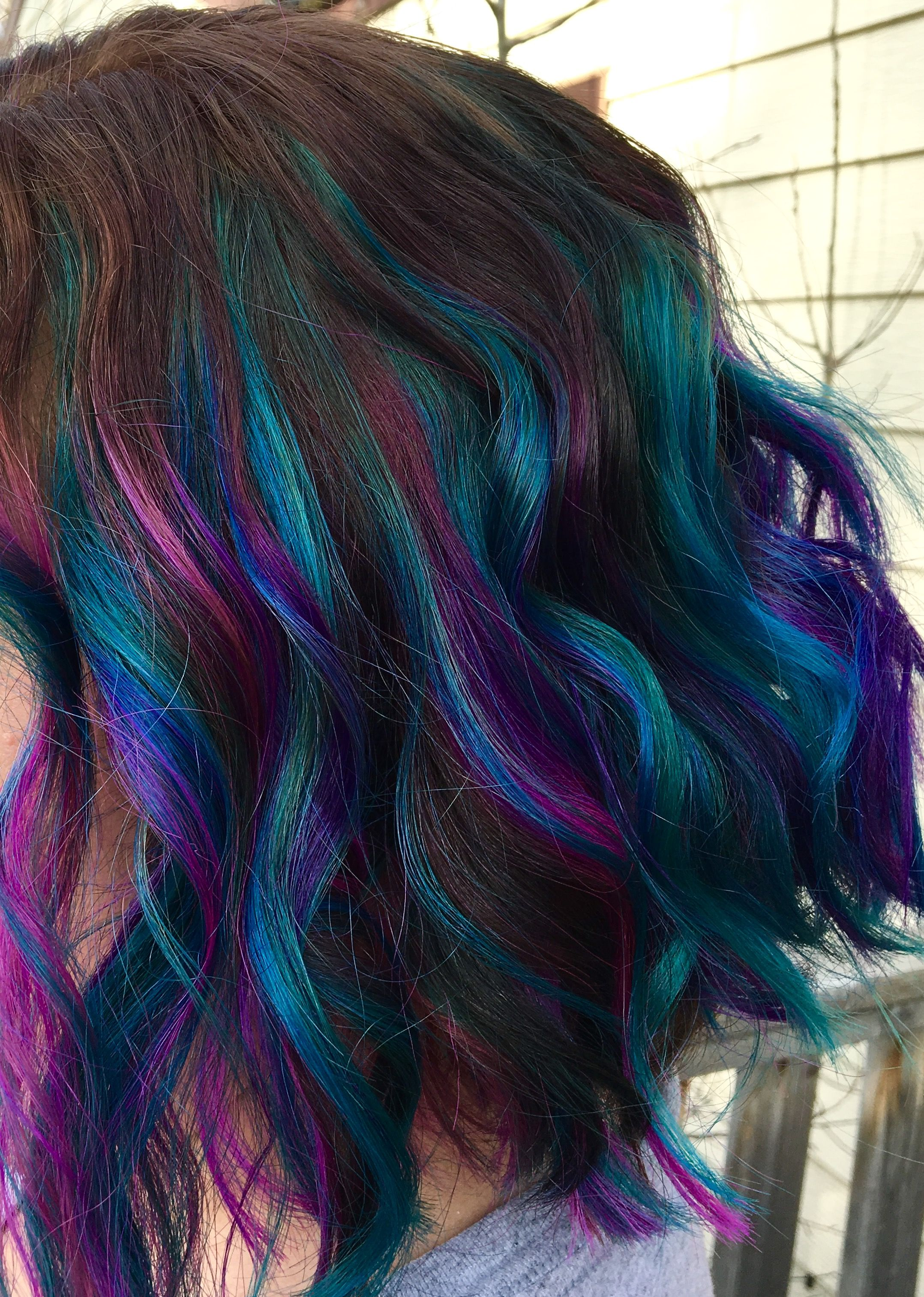 Pink purple and teal balayage highlights hair and makeup by