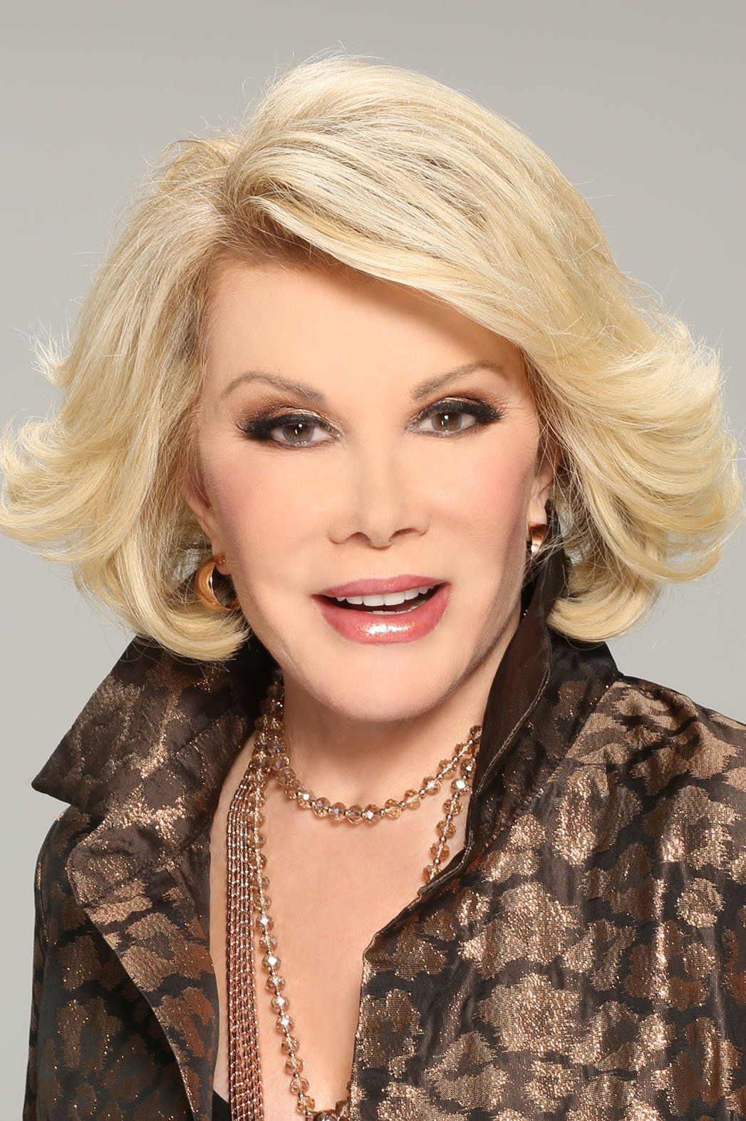 Throughout her decades-long career as a comic, actress, author, entrepreneur, television host, and playwright, Joan Rivers  (neé  Joan Alexandra Molinsky) ,exhibited an extraordinary personal fortitude that helped solidify her position as a polymath of American culture. Fiercely intelligent and always outspoken, her style and elegance were perfect foils to the transgressive, comedic bravura that defned her public persona.