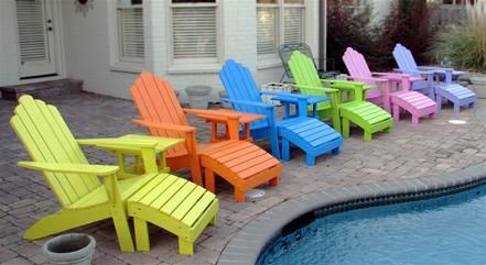 Multi Color Adirondack Chairs Around The Pool