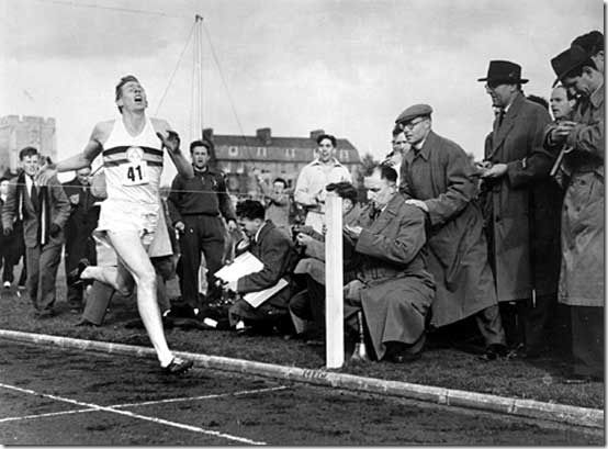 May 6, 1954. Medical student Roger Bannister breaks the 4 minute mile barrier, running it in 3:59.4, setting a world record at a track meet in Oxford, England.