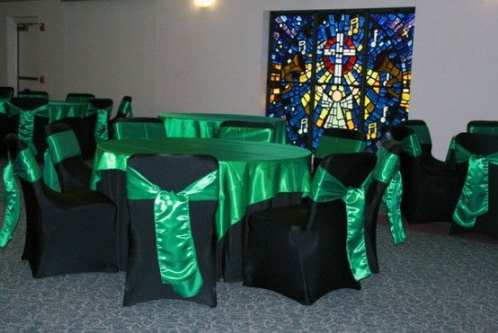 Set Up Featuring Emerald Green Overlays And Sashes Wedding