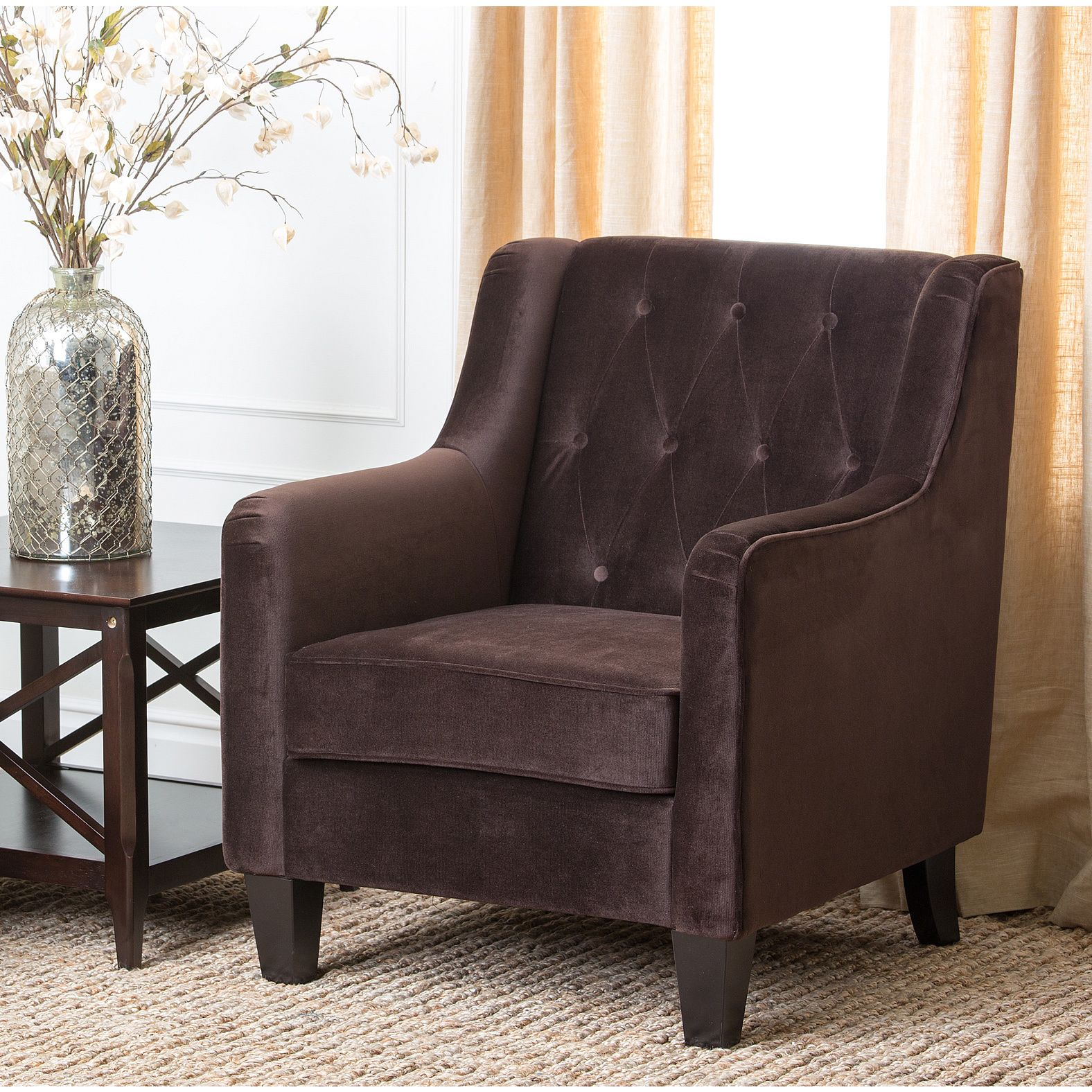 Enjoy this luxurious fabric Armchair for years to come. This chair features a solid frame with high quality microsuede fabric.