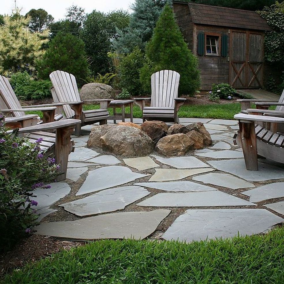Natural flagstone patio fire pit cement and patios for Garden patio ideas