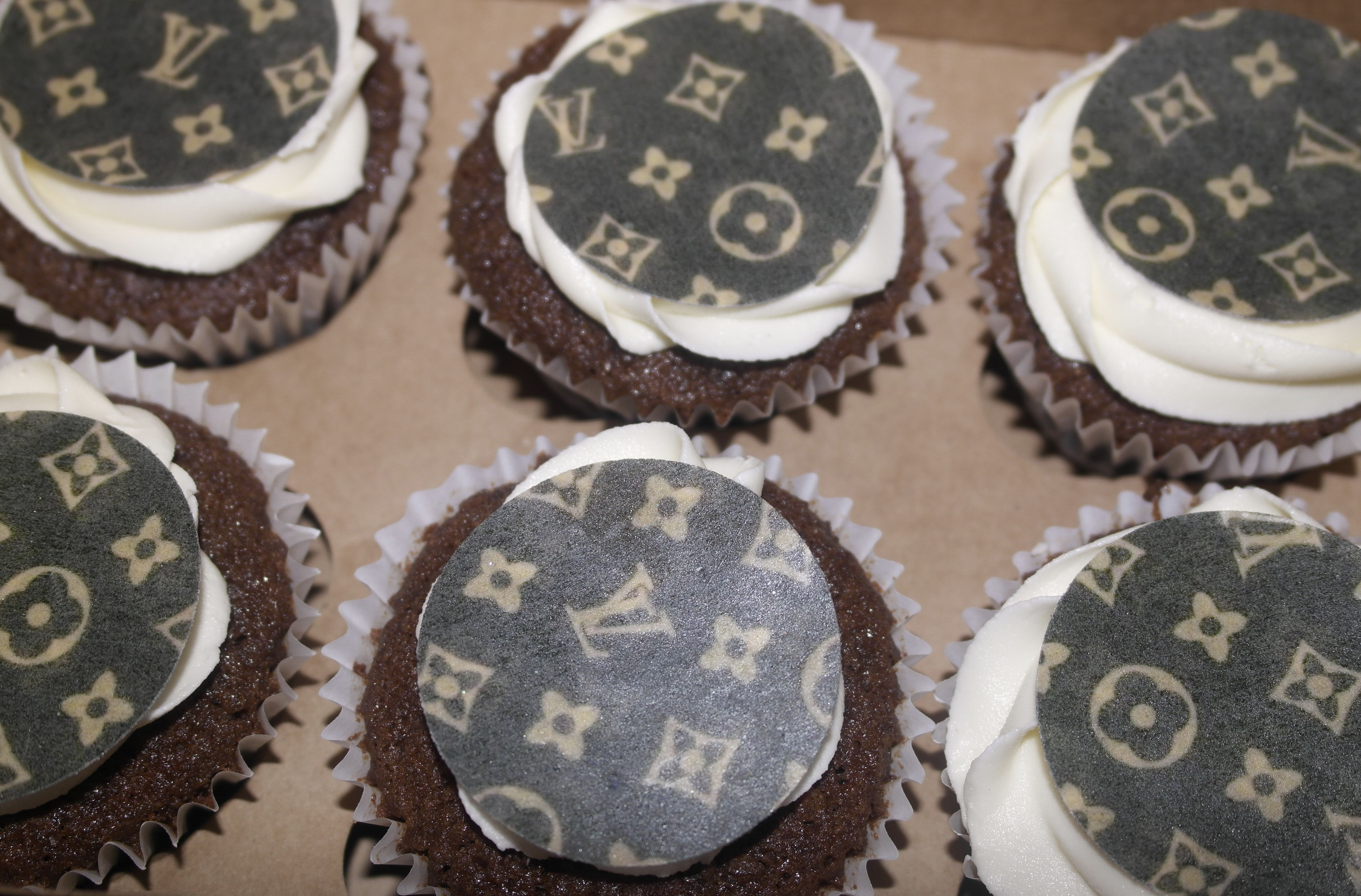 Louie Vuitton Cupcakes Rum Cupcakes with a Louie Vuitton print topper