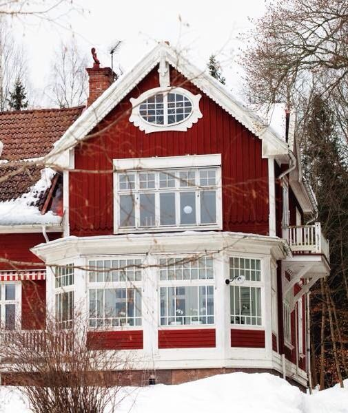 Red is Classic for a Swedish house. Gorgeous porch in the 20's style.