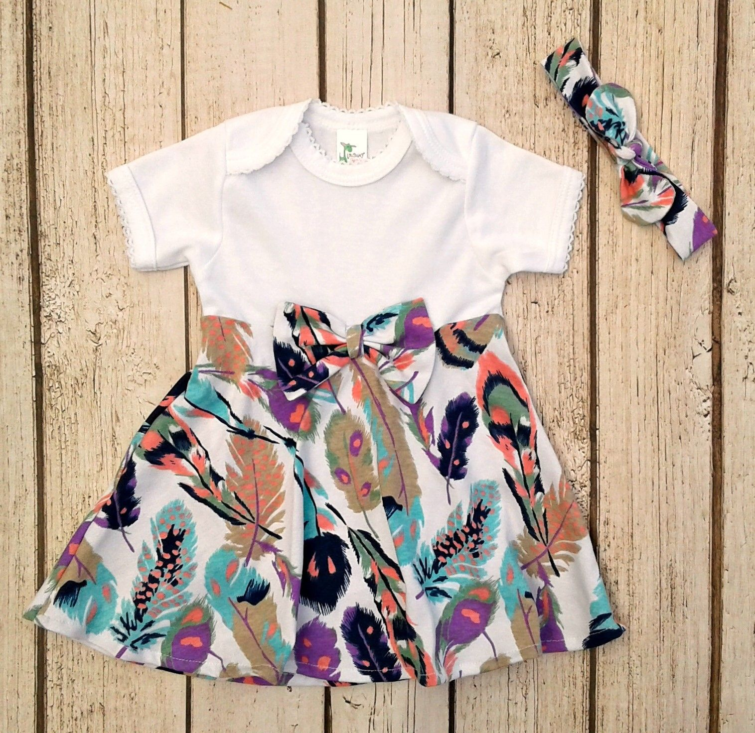 Like hippie or bohemian baby clothes This feather bodysuit dress is