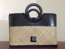 Every girl needs a Chic Criss-Cross pattern handbag.  This two-tone tote is made from upcycled layflat material, decorative stitching, criss-cross woven bamboo and bamboo handles.  The interior includes a zippered fabric closure to keep your items safe and out of sight.  This bag is only in Black (as Shown)  13x9x6