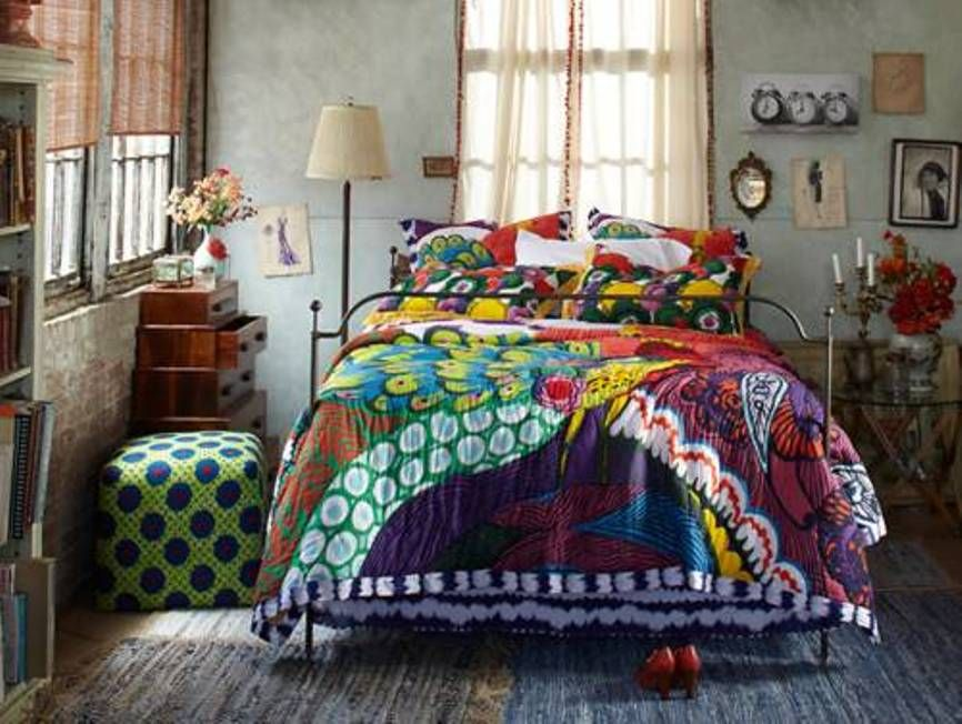 Boho Chic Bedroom With Colorfull Bedding And Glass Round Table And