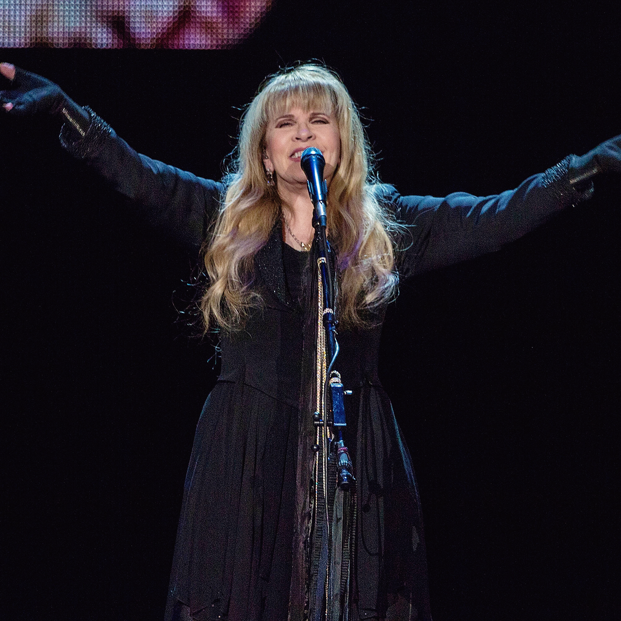 Stevie   ~ ☆♥❤♥☆ ~   smiling and holding her arms up high onstage, acknowledging the audience in the San Diego, California, concert, on March 2nd, 2017, during her '24 Karat Gold' US 2017 tour; photo credit: Daniel Knighton via Getty images