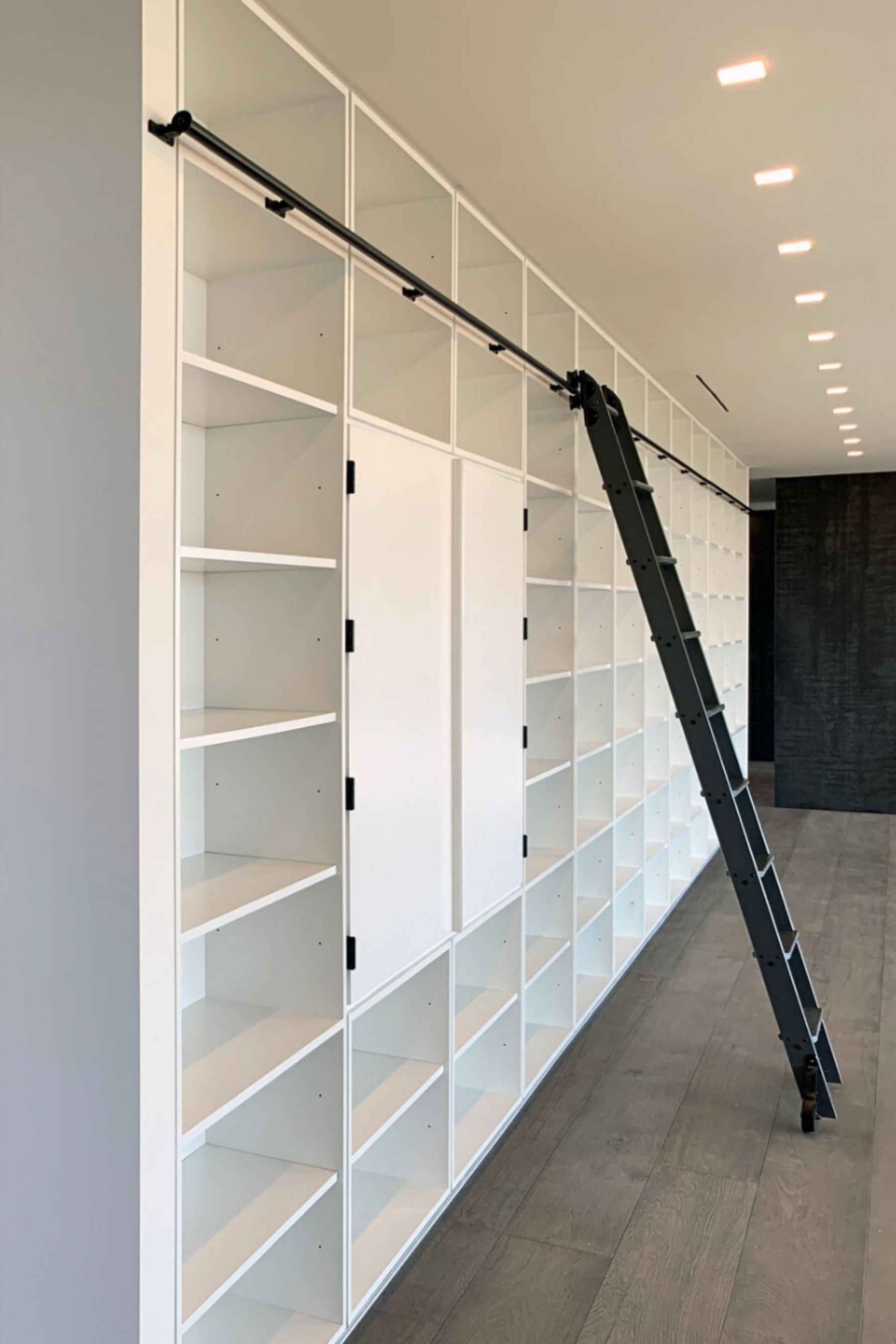 RES4 Modern Living with Wall of Bookshelves and Ladder A wall of bookshelves lines one side of the large open living  dining area at our RES4 Tower Hill House in Upstate...