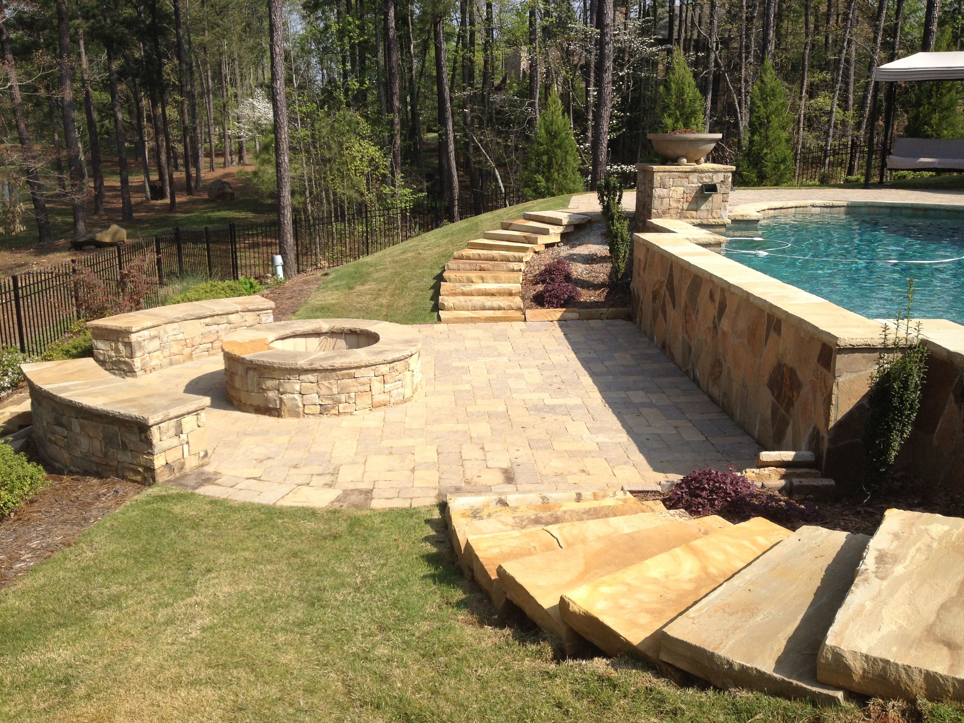 exposed pool wall | firepit | stone slab steps | pavers | decor