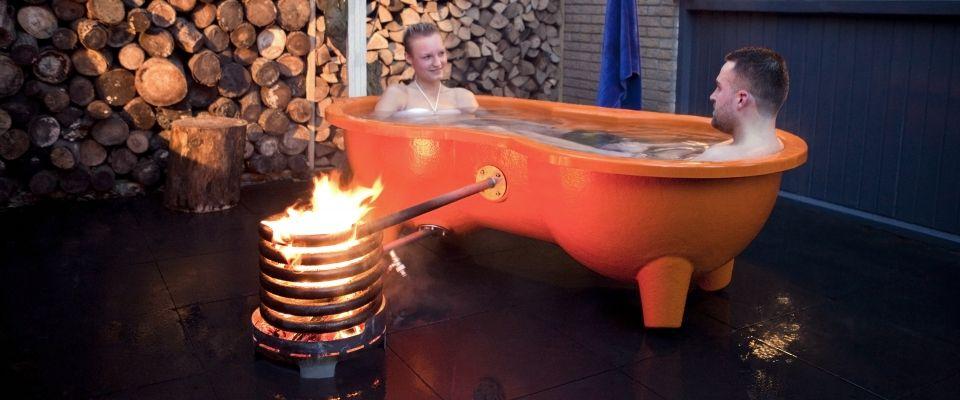 Dutchtub loveseat backyard...heats with wood... no