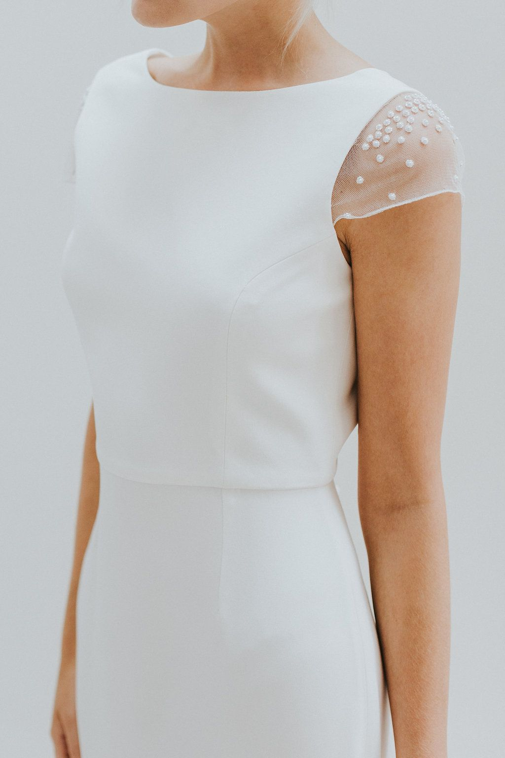 Simple modern wedding dress with hand embroidered cap sleeves and