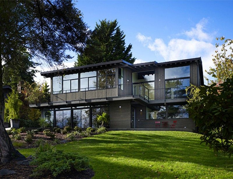 Two Storey Glass House Architecture In Modern Design For Family