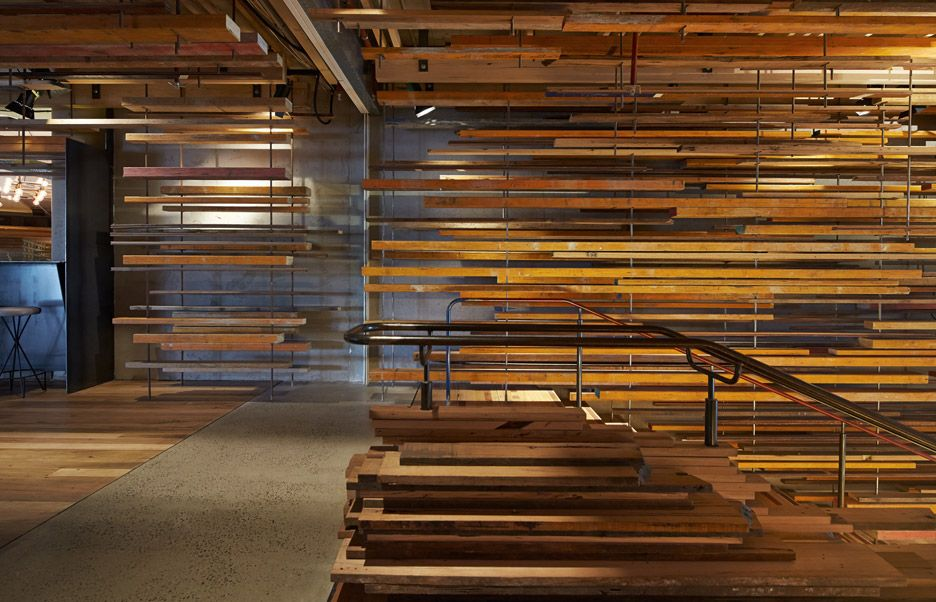 This sculptural timber lobby and utilitarian bar at a Canberra hotel has won World Interior of the Year.