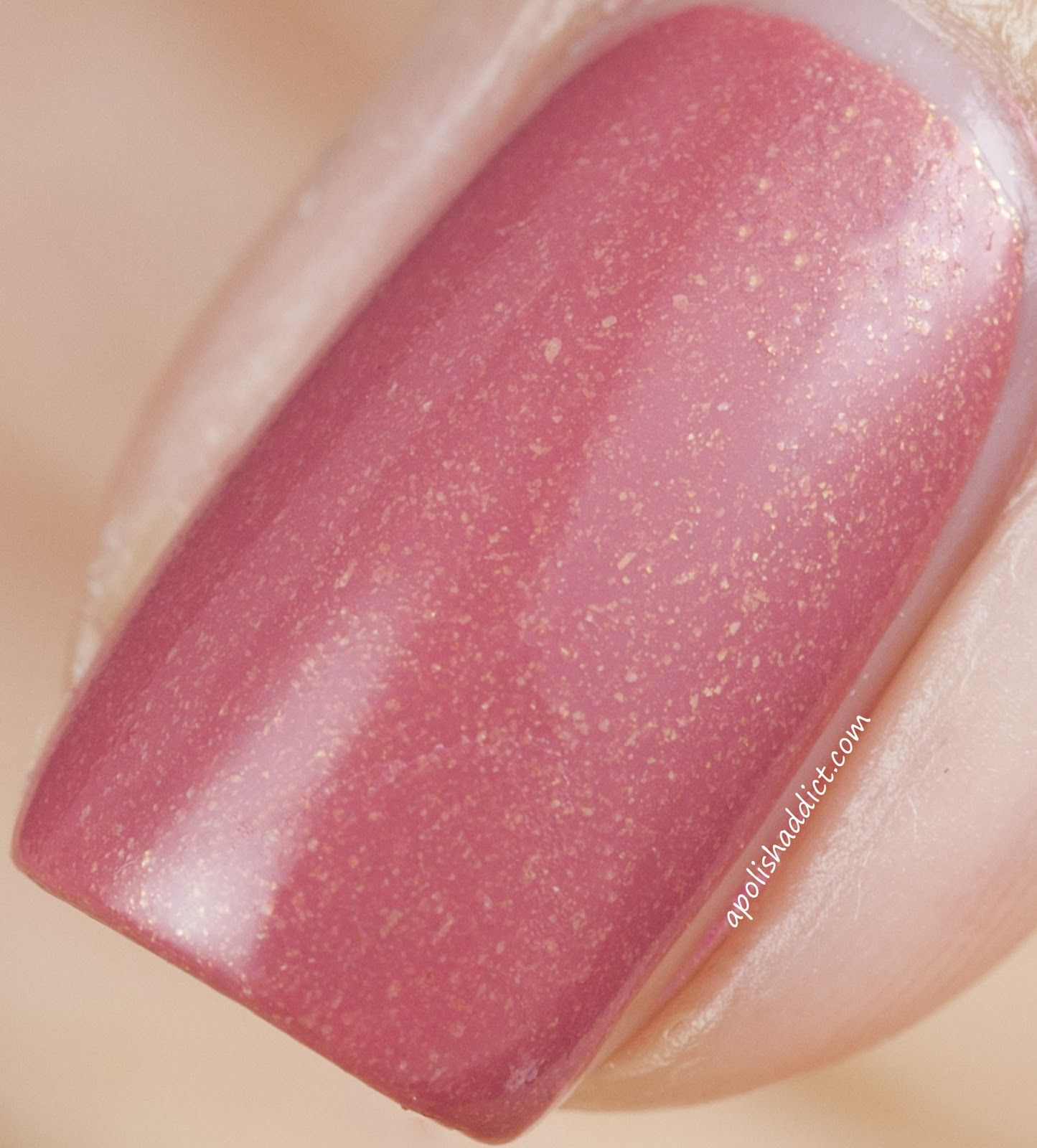 Essie All Tied Up - a rosy bronze with gold glitter. I really like ...