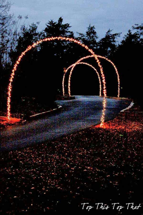 Lighted Arches Going Up The Driveway