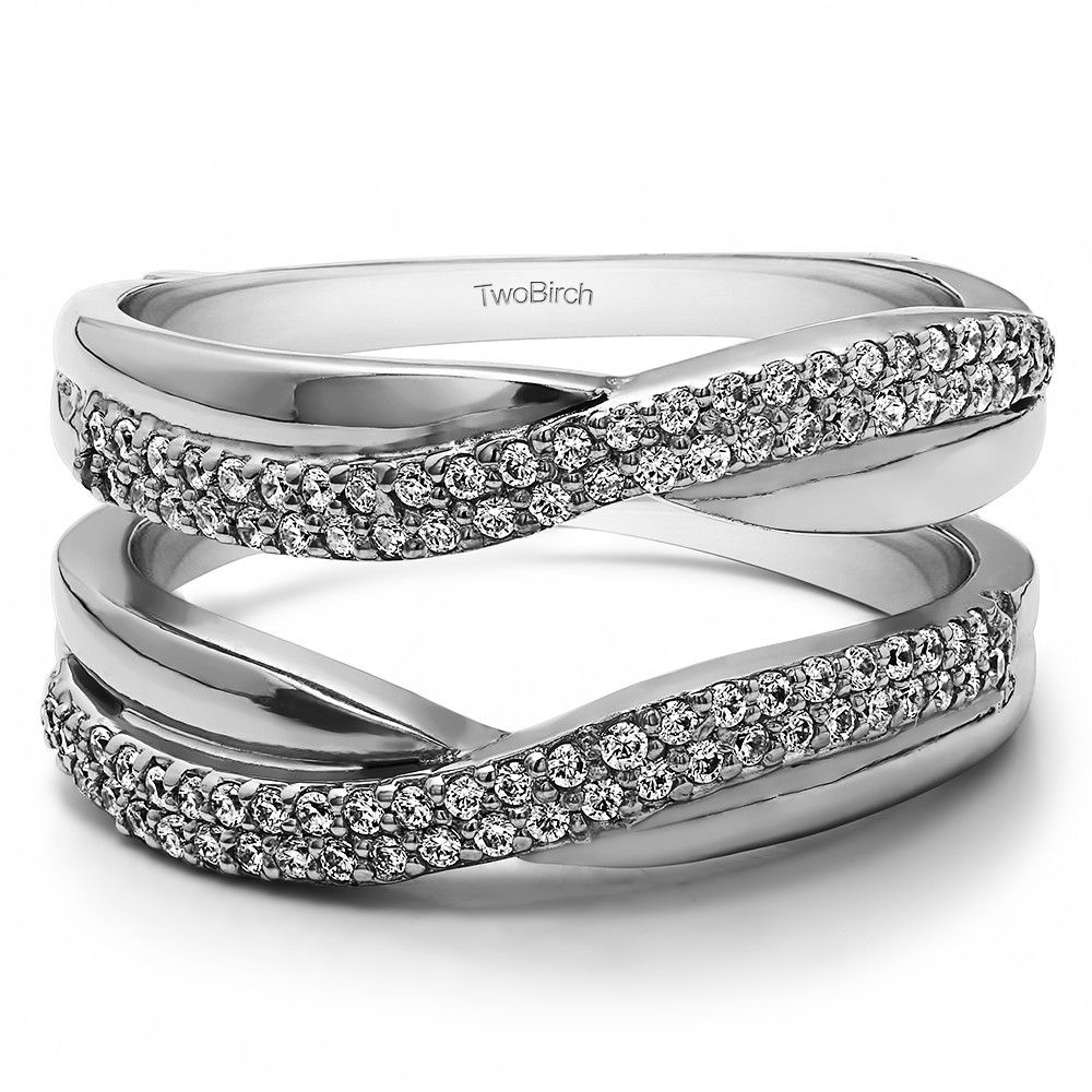This wedding ring guard has 94 round, prong set stones