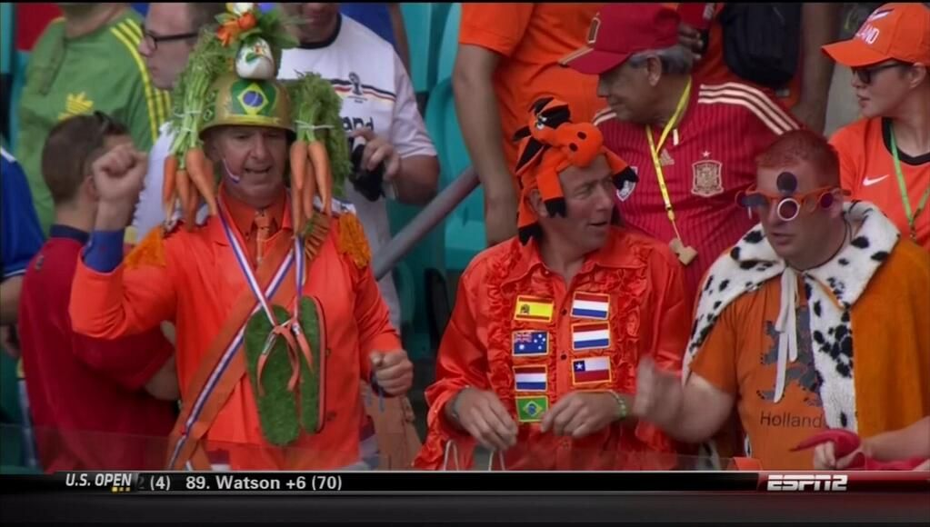 Netherlands supporters at opening match versus Spain. Who knew Carrot Top was a Dutch fan? Hup Holland Hup