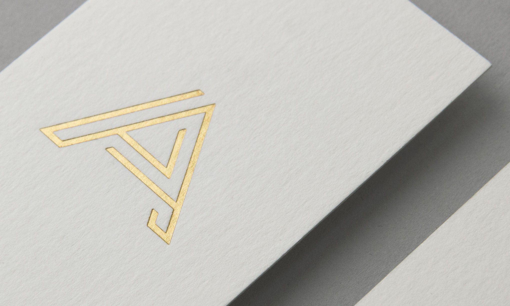 visual identity and gold foiled business cards for aurum