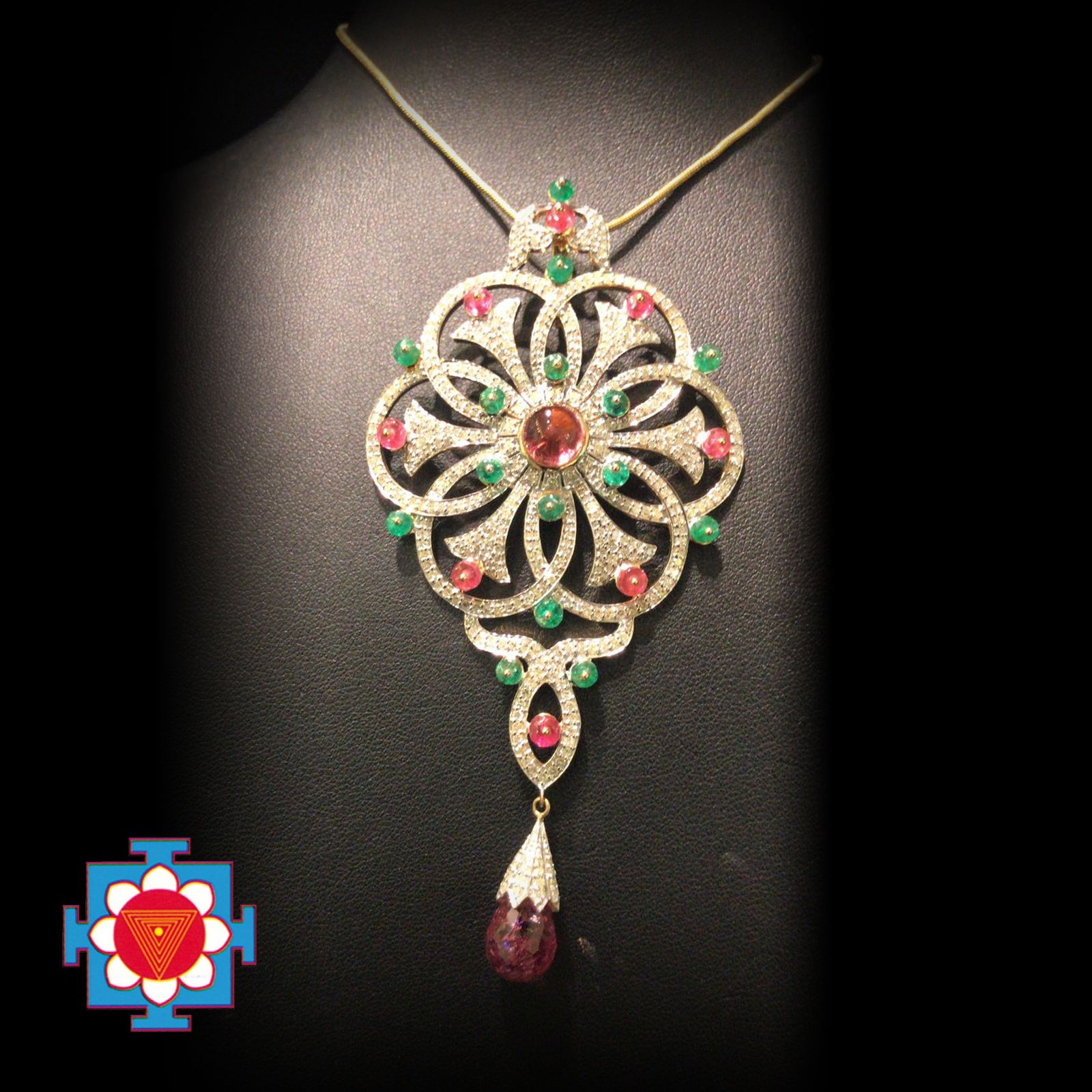Pendant set in kt gold with diamonds pink cabochon turmaline and