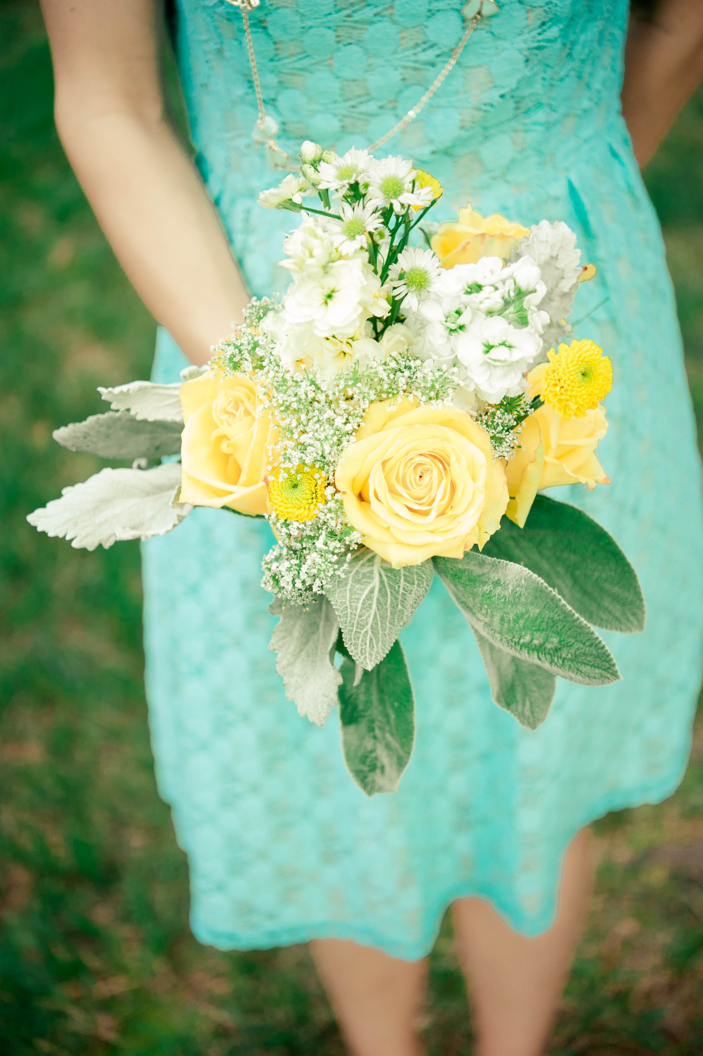 Light blue bridesmaid dress with yellow and white flowers blue