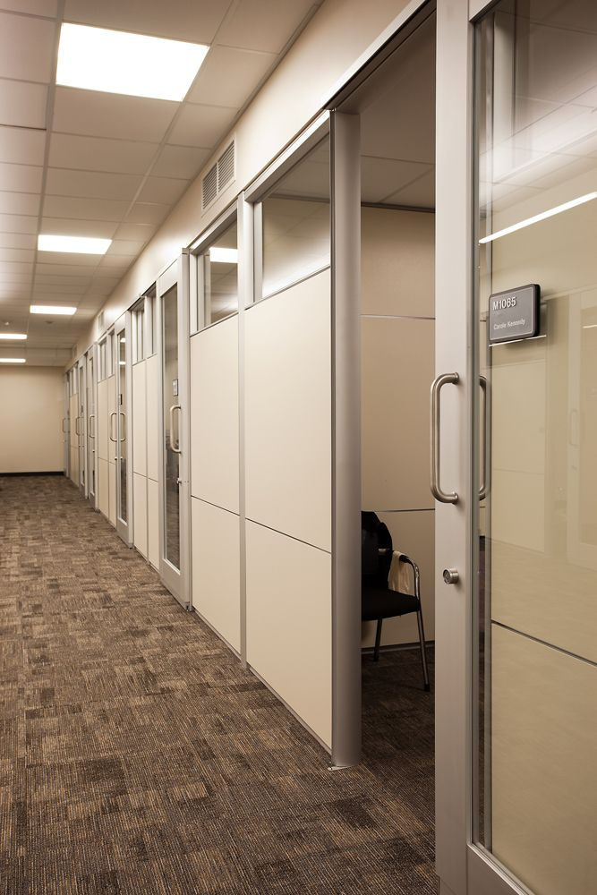 Arapahoe Community College - PRODUCT: DIRTT glass fronts with sliding barn  doors, combined with
