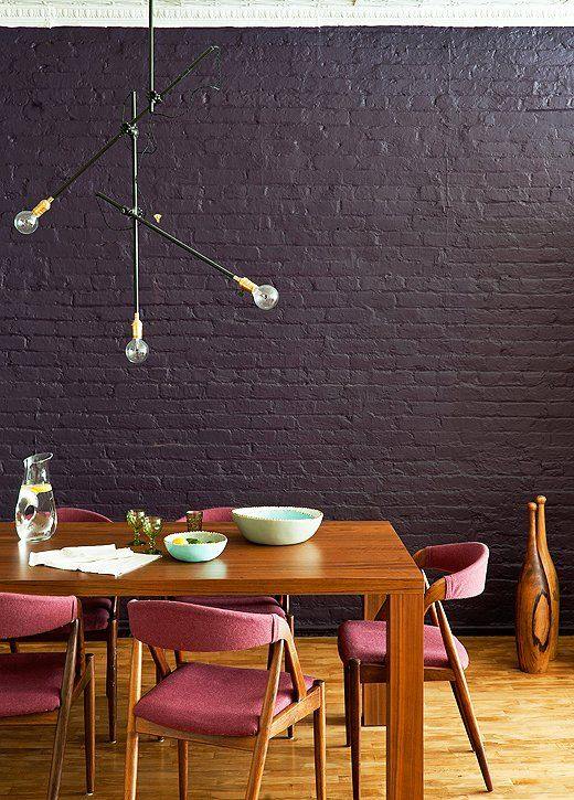 Photo by Matthew Williams/Livingetc/IPC+ Syndication  #dining_room with #black_brick_wall #modern_furniture