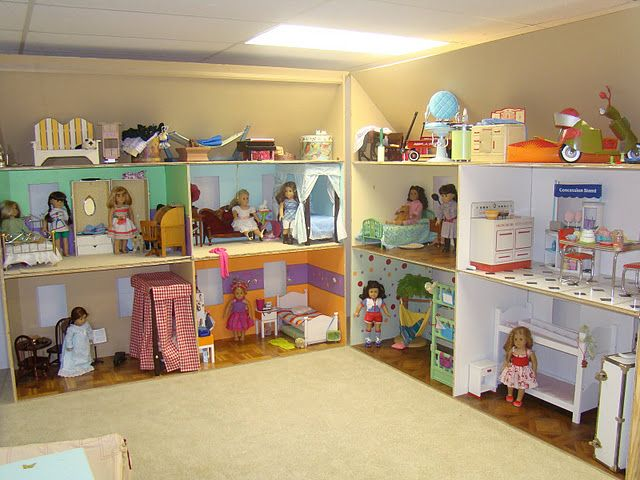 amazing! huge American Girl dollhouse: i just looked through this Picasa album... amazing! this was made for three girls (judging from the pics), i think we could do nicely with one unit and then a shelf for storing the unused items of the day... next house must have space for this!  a mom can dream!!  ;)