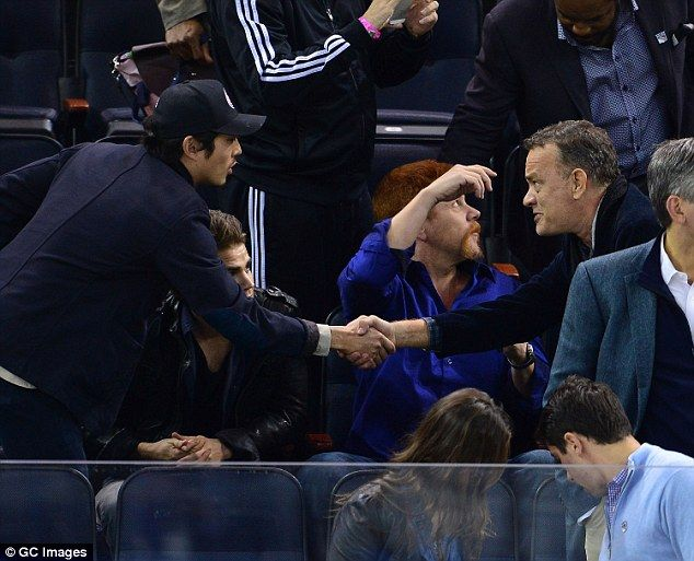 No Zombies Tom Hanks Graciously Shook Hands With Steven Yeun Who Looked Thrilled To Meet The Star When He Happe Tom Hanks Walking Dead Cast The Walking Dead