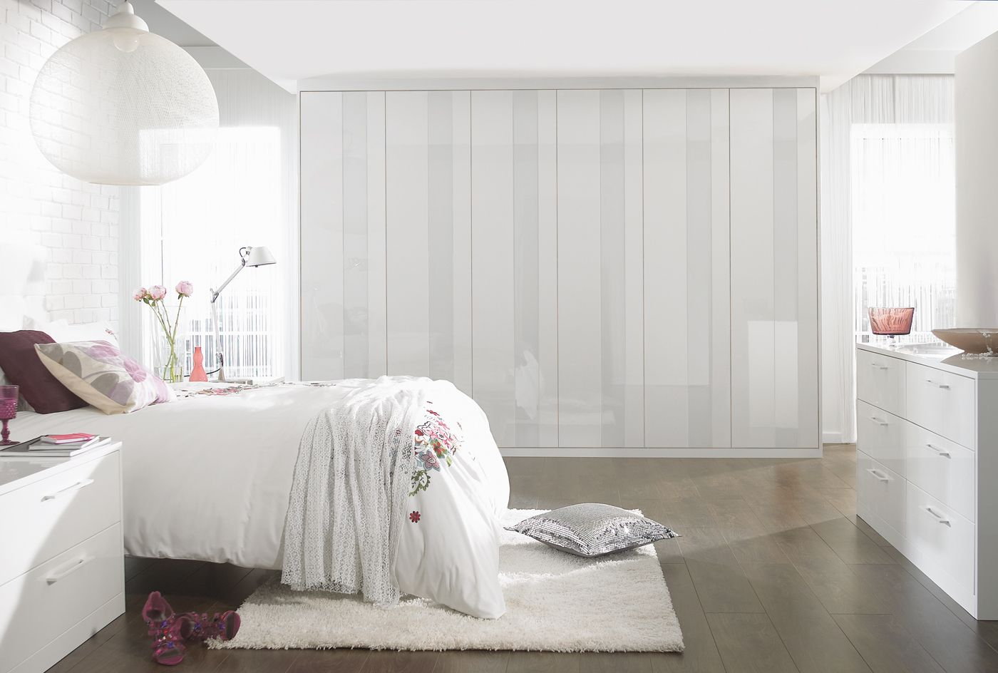 The Vetro is a white high gloss bedroom range with touch close