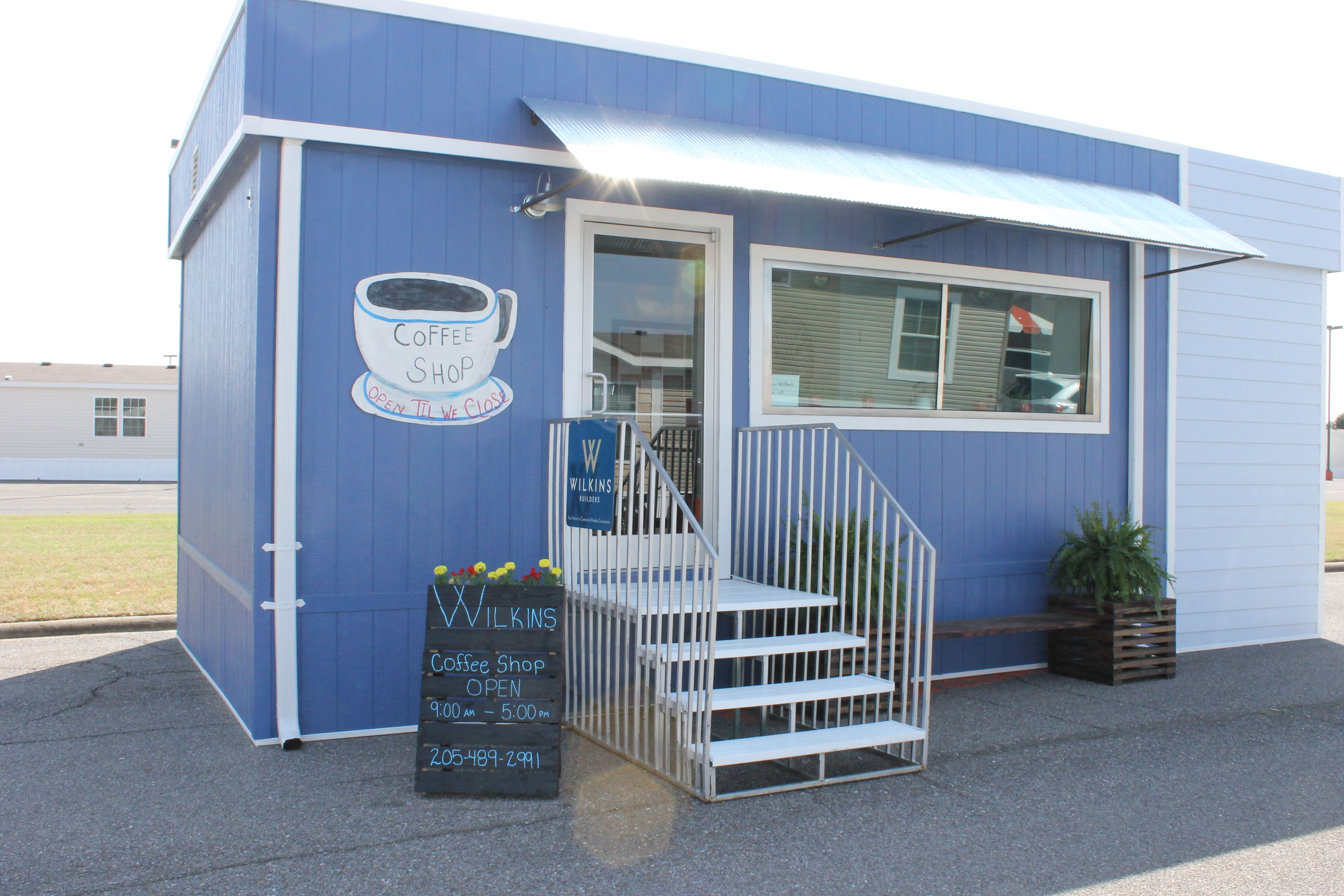 custom commercial modular building with a hing awning