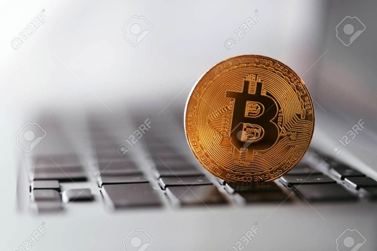Currency Bitcoin On Keyboard Closeup Virtual Money Coin On Computer High Resolution Stock Photo Digital Currency Bitcoin On Keyboard Closeup Virtual Money Coin On Compute...