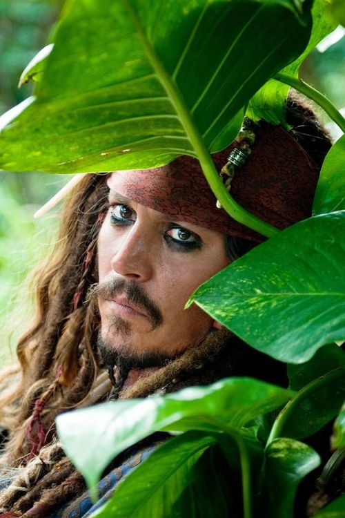Captain Jack Sparrow (Johnny Depp) in Pirates of the Caribbean. Great movie. Male actor. Costume, I am in love, portrait, intense, photo
