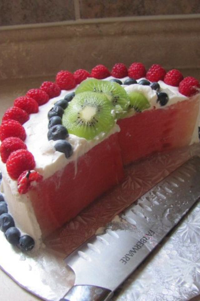 Cake made of fruit Cool whip icing watermelon kiwi and berries