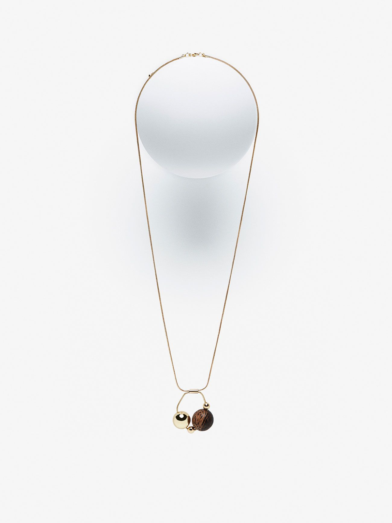 Necklace comprising a wooden dial and a metallic dial hanging from a
